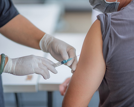 A Person Getting the COVID-19 Vaccine
